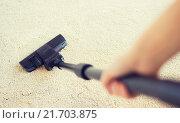 Купить «close up of hand with vacuum cleaner at home», фото № 21703875, снято 18 февраля 2015 г. (c) Syda Productions / Фотобанк Лори