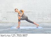 Купить «woman making yoga low angle lunge pose on mat», фото № 21703907, снято 13 ноября 2015 г. (c) Syda Productions / Фотобанк Лори