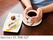 Купить «close up of woman holding coffee cup and dessert», фото № 21704127, снято 1 декабря 2015 г. (c) Syda Productions / Фотобанк Лори