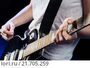 Купить «musician playing electric guitar with mediator», фото № 21705259, снято 20 октября 2014 г. (c) Syda Productions / Фотобанк Лори