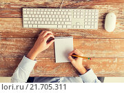 Купить «close up of hands with notebook and keyboard», фото № 21705311, снято 10 октября 2014 г. (c) Syda Productions / Фотобанк Лори