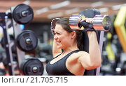 Купить «young woman flexing muscles with dumbbell in gym», фото № 21705715, снято 12 декабря 2015 г. (c) Syda Productions / Фотобанк Лори