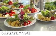 Купить «Сервировка стола с фруктами и овощами», видеоролик № 21711843, снято 18 июня 2015 г. (c) Denis Mishchenko / Фотобанк Лори