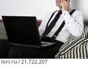 Купить «businessman sitting on couch with phone and labtop», фото № 21722207, снято 20 апреля 2018 г. (c) PantherMedia / Фотобанк Лори