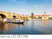Купить «View of Prague, Charles bridge and the Vltava river with tourist boats floating by on a summer day, Czech republic», фото № 21751743, снято 5 сентября 2014 г. (c) Наталья Волкова / Фотобанк Лори