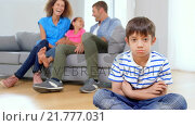 Купить «Son apart with family behind», видеоролик № 21777031, снято 23 августа 2019 г. (c) Wavebreak Media / Фотобанк Лори