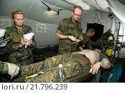 Купить «Gardelegen, Germany, mobile medical vehicle Bundeswehr», фото № 21796239, снято 3 июля 2014 г. (c) Caro Photoagency / Фотобанк Лори