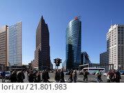 Купить «Berlin, Germany, and passers-end buildings at Potsdamer Platz», фото № 21801983, снято 29 марта 2011 г. (c) Caro Photoagency / Фотобанк Лори