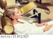 Купить «beautiful young woman sitting in bath robe at spa», фото № 21812927, снято 15 декабря 2014 г. (c) Syda Productions / Фотобанк Лори