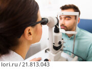 Купить «optician with slit lamp and patient at eye clinic», фото № 21813043, снято 25 ноября 2015 г. (c) Syda Productions / Фотобанк Лори