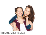 Купить «happy smiling pretty teenage girls hugging», фото № 21813223, снято 19 декабря 2015 г. (c) Syda Productions / Фотобанк Лори