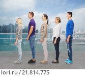 Купить «group of people over city waterside background», фото № 21814775, снято 21 октября 2015 г. (c) Syda Productions / Фотобанк Лори