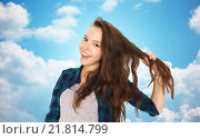 happy teenage girl holding strand of her hair. Стоковое фото, фотограф Syda Productions / Фотобанк Лори