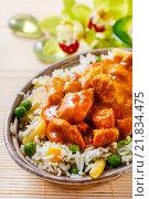 Купить «Chicken curry with basmati rice and green peas, dish popular in India.», фото № 21834475, снято 16 декабря 2019 г. (c) BE&W Photo / Фотобанк Лори