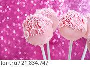 Купить «Pink cake pops decorated with sprinkles. Pink glittering background», фото № 21834747, снято 23 марта 2019 г. (c) BE&W Photo / Фотобанк Лори