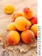 Купить «Stack of apricots on jute background. Healthy food», фото № 21835107, снято 20 марта 2019 г. (c) BE&W Photo / Фотобанк Лори