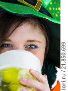 Купить «Pretty brunette celebrating Saint Patricks day», фото № 21850699, снято 20 февраля 2015 г. (c) Wavebreak Media / Фотобанк Лори