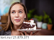 Sweet tooth woman holding piece of cake. Стоковое фото, агентство Wavebreak Media / Фотобанк Лори