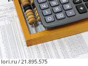 Купить «Калькулятор, счеты и цифры на листе. Бизнес-натюрморт», эксклюзивное фото № 21895575, снято 20 февраля 2016 г. (c) Юрий Морозов / Фотобанк Лори