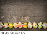 Купить «Easter eggs on wooden», фото № 21897579, снято 21 февраля 2016 г. (c) Типляшина Евгения / Фотобанк Лори