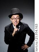 Купить «Young man in black coat and hat against gray», фото № 21914163, снято 12 марта 2014 г. (c) Elnur / Фотобанк Лори
