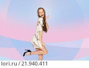Купить «happy young woman or teen girl in fancy dress», фото № 21940411, снято 31 октября 2015 г. (c) Syda Productions / Фотобанк Лори