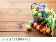 Купить «close up of easter eggs in basket and flowers», фото № 21940495, снято 28 января 2016 г. (c) Syda Productions / Фотобанк Лори