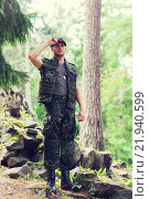 Купить «young soldier or ranger in forest», фото № 21940599, снято 14 августа 2014 г. (c) Syda Productions / Фотобанк Лори