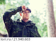 Купить «young soldier or ranger in forest», фото № 21940603, снято 14 августа 2014 г. (c) Syda Productions / Фотобанк Лори