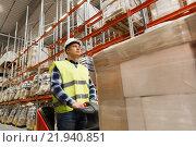 Купить «man on forklift loading cargo at warehouse», фото № 21940851, снято 9 декабря 2015 г. (c) Syda Productions / Фотобанк Лори