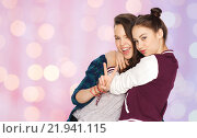 Купить «happy teenage girls hugging and showing peace sign», фото № 21941115, снято 19 декабря 2015 г. (c) Syda Productions / Фотобанк Лори