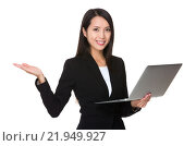 Купить «Young Businesswoman hold with notebook computer and hand showing blank sign», фото № 21949927, снято 23 мая 2019 г. (c) PantherMedia / Фотобанк Лори