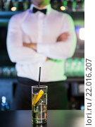Купить «Glass of gin on bar counter», фото № 22016207, снято 22 сентября 2015 г. (c) Wavebreak Media / Фотобанк Лори