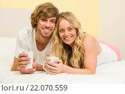 Купить «Cute couple having coffee», фото № 22070559, снято 8 сентября 2015 г. (c) Wavebreak Media / Фотобанк Лори