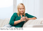 Купить «happy woman with cup of tea or coffee at home», фото № 22079015, снято 7 февраля 2016 г. (c) Syda Productions / Фотобанк Лори