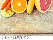 Купить «close up of fresh juicy fruits on table», фото № 22079115, снято 17 марта 2015 г. (c) Syda Productions / Фотобанк Лори