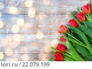 Купить «close up of red tulips on wooden background», фото № 22079199, снято 3 марта 2015 г. (c) Syda Productions / Фотобанк Лори