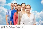 Купить «group of smiling people over blue sky and clouds», фото № 22079215, снято 21 октября 2015 г. (c) Syda Productions / Фотобанк Лори