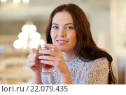 smiling young woman drinking tea at cafe. Стоковое фото, фотограф Syda Productions / Фотобанк Лори