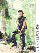Купить «young soldier or hunter with gun in forest», фото № 22079459, снято 14 августа 2014 г. (c) Syda Productions / Фотобанк Лори