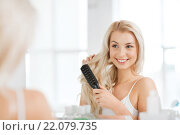 Купить «happy woman brushing hair with comb at bathroom», фото № 22079735, снято 13 февраля 2016 г. (c) Syda Productions / Фотобанк Лори