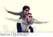 Купить «happy teenage couple in shades having fun outdoors», фото № 22079827, снято 19 марта 2015 г. (c) Syda Productions / Фотобанк Лори