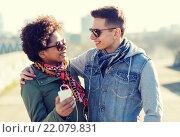 Купить «smiling couple with smartphone and earphones», фото № 22079831, снято 19 марта 2015 г. (c) Syda Productions / Фотобанк Лори