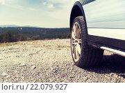 Купить «close up of dirty car wheel on cliff», фото № 22079927, снято 28 марта 2015 г. (c) Syda Productions / Фотобанк Лори