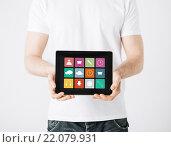 Купить «close up of man with app icons on tablet pc», фото № 22079931, снято 21 марта 2013 г. (c) Syda Productions / Фотобанк Лори