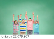 Купить «happy children celebrating victory over green», фото № 22079967, снято 31 января 2016 г. (c) Syda Productions / Фотобанк Лори