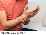 Купить «close up of man with pain in hand at home», фото № 22080067, снято 15 января 2016 г. (c) Syda Productions / Фотобанк Лори