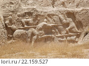 Купить «The relief of equestrian victory of Hormozd II over the regional enemy at Naqsh-e Rustam, Iran. Naqsh-e Rustam is an ancient necropolis located about 12 kilometres of Persepolis and few hundreds meter from Naqsh-e Rajab. The oldest relief dates to 1000 BC. Four tombs of Achaemenid kings are carved out of the rock face at a considerable height above the ground.», фото № 22159527, снято 23 июля 2019 г. (c) PantherMedia / Фотобанк Лори