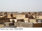 Купить «View of the town of Yadz, Iran, with the wind towers in the background. The town, capital of the Yadz Province, has a history of over 3000 yeras, dating back to the time of the Median Empire. Wind towers are important element in the persian architecture providing natural air conditioning and cool water for houses and water cisterns in dry and humid climate for thausands of years», фото № 22159559, снято 18 августа 2019 г. (c) PantherMedia / Фотобанк Лори