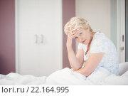 Купить «Portrait of senior woman suffering from headache», фото № 22164995, снято 9 ноября 2015 г. (c) Wavebreak Media / Фотобанк Лори
